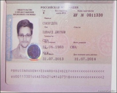 FUGITIVE FORMER U.S. SPY AGENCY CONTRACTOR EDWARD SNOWDEN'S NEW REFUGEE DOCUMENTS GRANTED BY RUSSIA IS SEEN DURING A NEWS CONFERENCE IN MOSCOW