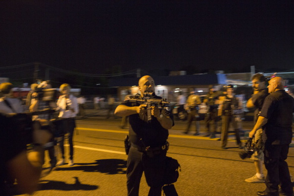 Cop Suspended Indefinitely After Threatening To Kill Ferguson Protestor